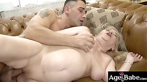 Kinky granny Betsy B asks young Mugur to takes her on the couch and bang